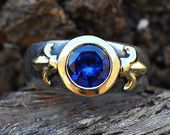 Fleur-de-lis ring with royal blue stone - gold and silver, US size 8 1/4
