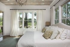 Barnwood ceiling  in master Bedroom:Waterside Home Tour: Simple Nature Decor
