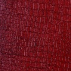 Cherry red, croc-embossed vinyl that feels like the real thing.  A hint of gloss separates this medium-weight faux leather from the rest of the pack.  Youul have to feel it to believe it.  Suitable for a variety of home applications, best for upholstery.