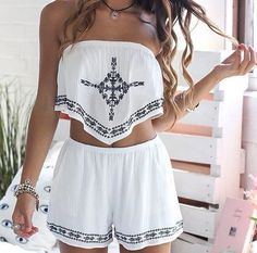 Loving this white 2 piece with navy detailing. High waisted shorts with a strapless crop top!