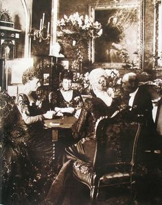A very home and Royal scene~ Empress of Russia (Maria Feodorovna) plays cards with Queen of England ( her sister Alexandra), future King of Denmark Frederick VIII (their brother) and Duchess of Cumberland ( their sister Thyra). 1902