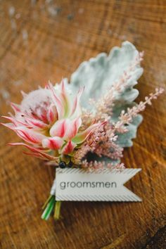 dusty leaf Beautiful boutonniere for the groomsmen! Photo by Apryl Ann Photography. Protea Wedding, Floral Wedding, Wedding Bouquets, Wedding Flowers, Protea Bouquet, Boutonnieres, Groomsmen Boutonniere, Wedding Boutonniere, Wedding Planning