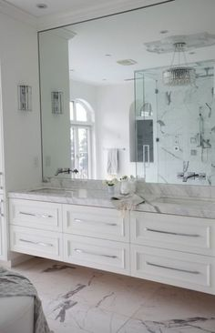 Love this floating vanity and the marble tiles. Don't love the vanity drawer hardware...