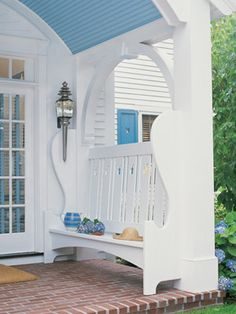 Designers William Diamond and Anthony Baratta made structural changes to the home, adding a front porch with built-in benches and antique carriage lanterns.     http://www.veranda.com/room-decorating/cape-cod-summer-house-0608?click=main_sr#slide-3