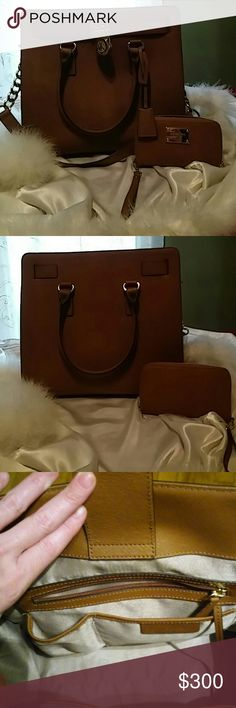 Michael Kors Hamilton and wallet😘 MAKE OFFER😘 New without tags. Gorgeous bag , camel in color , matches everything , And wallet too!There are just some Tiny nicks on the shoulder strap , not even noticable really, unless inspected very carefully , so price reflects that Just to big for me ...Make offer ,i will most certainly consider. Michael Kors Accessories