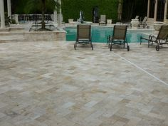 Travertine marble pavers for a residential pool deck remodel. What an amazing look! Bluestone Pavers, Travertine Pavers, Deck Cost, Deck Shade, Garden Paving, Shade Structure, Deck Lighting, Swimming Pool Designs, Pool Decks