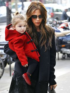 Victoria Beckham and daughter Harper. I love her adorable little red coat!