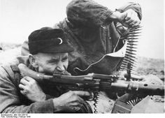 German Volkssturm militia fighters fire their MG-34 machine gun at the Russians in one of the last, desperate battles in Silesia (now in Poland) Feb 1945. The machine gunner is in his late 50s, perhaps early 60s. The feeder can't be seen clearly but he shouldn't be any younger. Their statistical hope of survival was near zero.