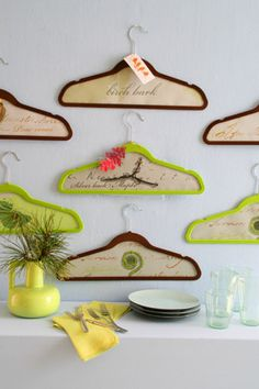"We love designer Matthew Mead's knack for morphing everyday objects into instant (and wallet-friendly) wall art. Here, he painted wood hangers in shades of bright green and warm brown, then adhered woodland images to the backs. Use wrapping paper, wallpaper, fabric scraps, magazine images-anything that says ""nature"" to you. Matthew embellished a few of the hanger frames with extra cutouts of leaves and birds. Then, he hung the finished pieces from clear thumbtacks in the wall."