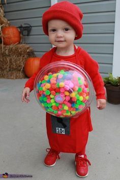 Jill: My daughter, Lyla is wearing the costume. Made from a red child size apron, some craft pompoms, a plastic bowl and kid and some felt.