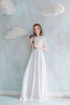 Elegant ivory-colored wedding dress floor length by Goroshina