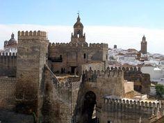 CASTLES OF SPAIN - Puerta de Sevilla, Carmona, provincia de Sevilla. Acceso a la ciudad de Carmona, enmarcado en una fortaleza. Los cartagineses la comenzaron en el año 206 a.C. Los romanos  la reformaron en los siglos II y I a.C. Los almohades añadieron arcos de herradura, así como aljibes, y barbacanas (s.IX y XII). Trás la conquista de Málaga por los Reyes Católicos, su alcaide Amet-el Zegrí, estuvo cautivo hasta su muerte en una de sus torres.
