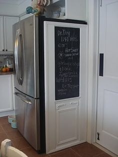 Old Door With Chalkboard To Hide Side Of Refrigerator