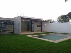 Residencia de una planta, de estilo minimalista moderno, ubicada en una zona residencial de Cholul, que se encuentra rodeada de amplias aven...121949312