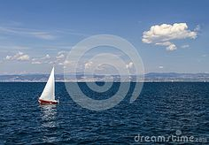 Sailboat in clear sunny weather on the calm seas.
