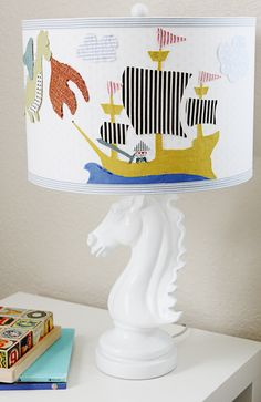 Big Boy Bed and toddler decorating ideas - a little glass box-8 do a lamp that sea wheels can be placed in instead of this base. Change color pattern up a little on shade.