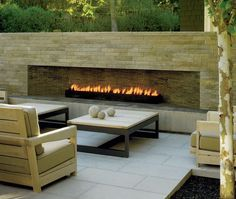 An outdoor fireplace design on your deck, patio or backyard living room instantly makes a perfect place for entertaining, creating a dramatic focal point. Modern Outdoor Fireplace, Outdoor Fireplace Designs, Rustic Fireplaces, Outdoor Fireplaces, Outside Fireplace, Home Fireplace, Fireplace Ideas, Linear Fireplace, Ethanol Fireplace