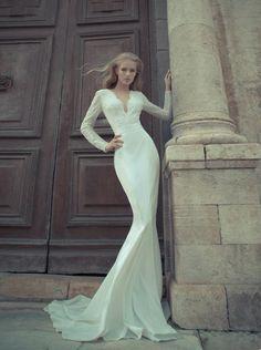 "Yaki Ravid--an Israeli designer, his exquisitely cut gowns scream ""haute couture.""  Talk about liquid silk..."