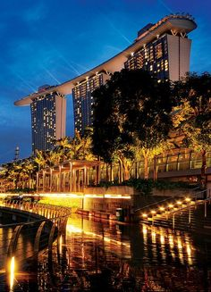 Reflections at Marina Bay Sands Singapore - A slight drizzle helps to brighten up the boardwalk with a golden sheen. Sands Singapore, Singapore City, Singapore Travel, Singapore Photos, Places To Travel, Places To See, Tourist Places, Beautiful World, Beautiful Places