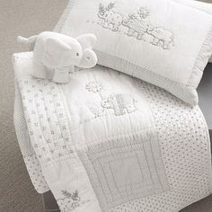 Baby Elephant Quilt & Cushion - A quilt brings some enchantment to any kid's room. This one is very delicate and can be for boys or girls.