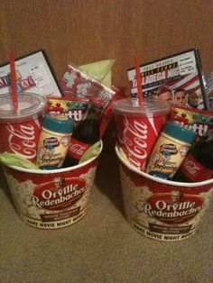 Buckets Gifts for a girl or guy for under $20. DVD, popcorn and bucket, plastic coke cups, skittles, popcorn seasoning, glass coke bottles and a bag of caramel popcorn as well. - ph
