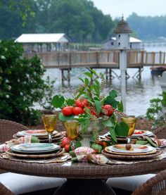 Summer table by the lake.  And, by the way, those are tomatoes!