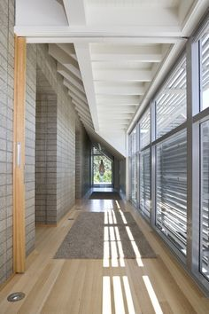 ... reveals how the sunshade works in concert with a louvered double-wall in the lower portion of the glass wall. When the sun is low, light will enter the upper portion to help heat the interior when it's cold.