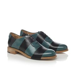 Brush off Italian leather oxford with hand-burnished stripes. This leather is a two-tone leather that has been painted with a top coat and then hand-burnished to create stripes. This leather will pati