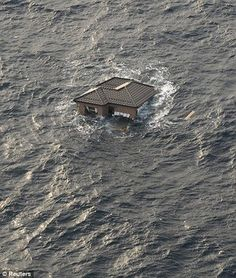 A Japanese home is seen adrift in the Pacific Ocean on March The structure was spotted as ships and aircraft from the Ronald Reagan Carrier Strike Group were searching for survivors in the coastal waters near Sendai, Japan. Japan Earthquake, Earthquake And Tsunami, Sendai, Tsunami 2011, Powerful Images, Floating House, Armada, Japanese House, Natural Disasters