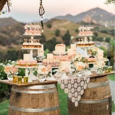 {So Chic} Perfect for an elegant, outside wedding reception! Use a couple barrels to create a fabulous dessert table {Inspired by The Wedding Chicks}