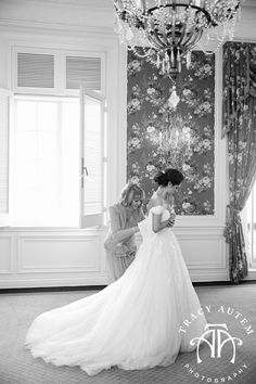 classic getting ready photo every bride needs.  Mom helping her daughter into her Pronovias gown at The Fort Worth Club in the Camilla Room.  Wedding photo must have!