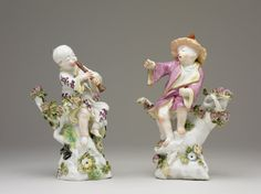 Chelsea Porcelain Factory Date1755-1757 (circa) | Pair of statuettes; porcelain; boys in Chinese style, one playing flute; on rustic bases with flowers and foliage in relief; painted in colours with slight gilding; marked.