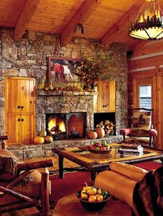 Smokey Mountain Retreat ~ Design elements and accent pieces in rich earth tones and vivid fabrics prove that Western style is alive and well in this log cabin retreat. Cowhide furnishings and hickory floors blend well with the wooden tables, chairs, and desks fashioned by local craftspeople. Pillows and throws exude festive colors and patterns indicative of American Indian and Western life.