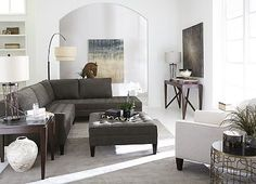 I like this dark gray couch. Would look great with two golden armchairs I already have.