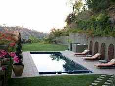 Spa Pool combination with automatic cover. Beautiful retaining wall makes it all possible!
