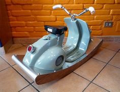 This Vespa-inspired scooter for kids is the ideal buy if you have two grand to spend on a toy. The rocking-scooter is superbly outfitted, and handmade Scooters Vespa, Vespa Vintage, Italian Scooter, Car Furniture, Automotive Furniture, Steel Detail, Cool Bike Accessories, Bike Seat, Trash To Treasure