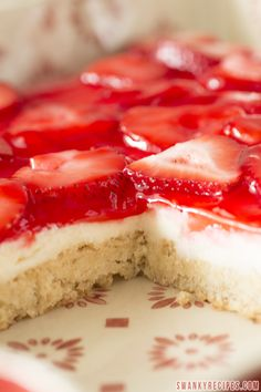 Strawberries and Cream Bars...A soft sugar cookie crust with a smooth and silky white chocolate and cream cheesecake center. The top is smothered with a fresh strawberry topping.