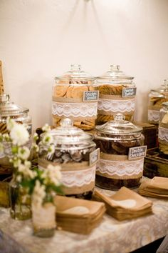 Cookie bar instead of a candy bar...love the lace idea around all the jars...inspiration for centerpieces...