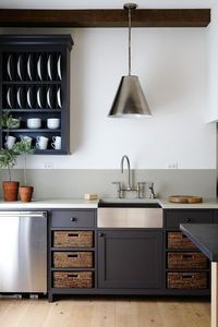 Refined Farmhouse Style Kitchen Lynda Reeves used industrial elements and dark-grey kitchen cabinets to update country style. Home Interior, Kitchen Interior, New Kitchen, Kitchen Dining, Kitchen Decor, Kitchen Sink, Interior Design, Kitchen Colors, Shaker Kitchen