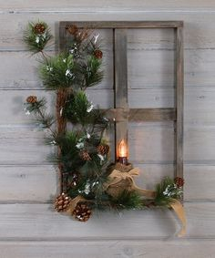 Embellish your walls with this rustic frame with frosted holly for a serene winter scene.