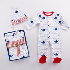 *Please allow 5-7business days + ship time.    VIEW SHIPPING RATES/ MAP FOR THIS ITEM     Send your little sailor gently and softly off to sleep in this adorable and comfy footed sleeper pajamas and matching cap featuring a nautical theme that includes colors of red, white and blue waves, whales and boat anchors.  DETAILS: White cotton interlock one-piece pajama with a blue wave and navy blue whale print and red details around the neck and feet - machine washable.   Matching knitted…