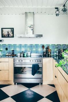 A colorful backsplash brightens up this space. | http://domino.com