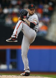 NEW YORK, NY - AUGUST 2: Jake Peavy #43 of the San Francisco Giants delivers a pitch against the New York Mets in the first inning on August 2, 2014 at Citi Field in the Flushing neighborhood of the Queens borough of New York City. (Photo by Rich Schultz/Getty Images)