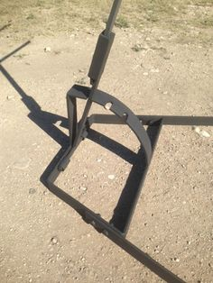 Asado Cross with Adjustable Base used over an open wood fire pit. Cross is high with 3 long horizontal crosses. Adjustable Base is high. Fire Cooking, Outdoor Cooking, Asado Grill, Argentine Grill, Wood Fire Pit, Fire Pits, Get Off The Grid, Wrought Iron Chairs, Retractable Pergola