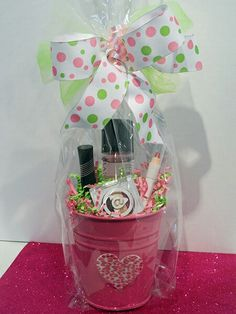 Mary Kay At Play shadow & eye crayon are paired with your choice of Mary Kay mascara & eye makeup remover.  All placed inside this adorable bucket with ribbon, filling & sticker in colors to match our At Play line.