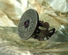 Fab ring design from Joan Williams of Lil Ruby at Etsy....the feature is a French coin!  Tres magnifique!
