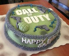 A Call Of Duty Birthday Cake 16 Inch Round Marble Topped With Buttercream Frosting And Fondant Details Including Guns Gernade