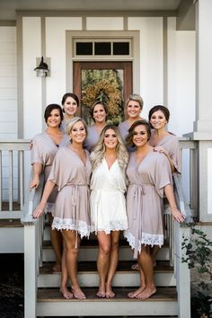 Bride and bridesmaids in matching robes getting ready for a Belle Meade Plantation wedding in Nashville. Nyk + Cali Wedding Photography: