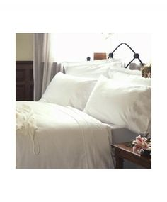 Egyptian cotton, high thread count sheets...it's a little piece of luxury I think everyone should treat themselves to.  Including me!  Well, if I could find it on sale... ;)