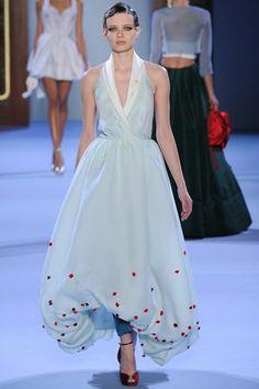 Add fullness and body in the skirt through a balloon hem.  Ulyana Sergeenko